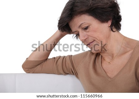 Mature woman reading - stock photo
