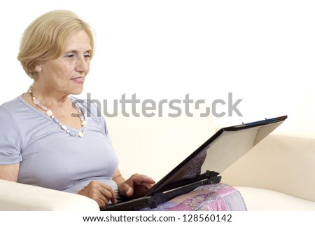 Mature woman relaxing at home on a white - stock photo