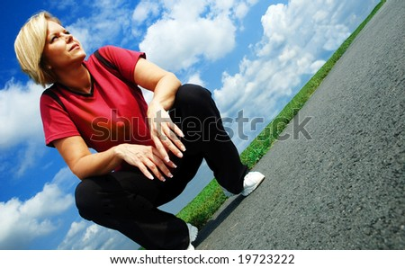 Mature woman resting on a summer day, low angle.