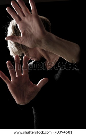 Mature woman scared of something/actress on stage - stock photo