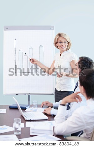 Mature woman shows a graph of the staff - stock photo