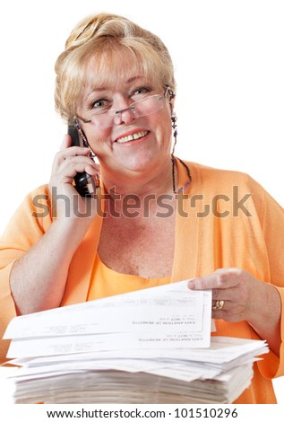Mature woman smiling as she resolves her problem with healthcare forms and paperwork - stock photo