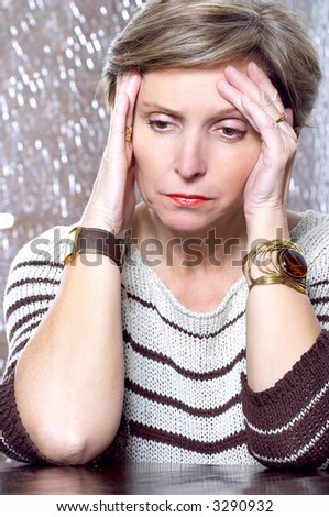 Mature woman suffering from depression - stock photo