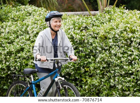 stock-photo-mature-woman-walking-with-her-mountain-bike-70876714.jpg
