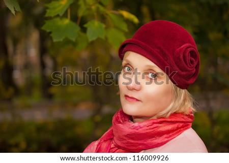 Mature woman wearing retro felt hat and wool coat . Outdoor, Handicraft. - stock photo