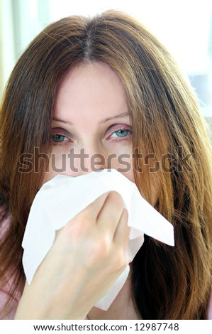 Mature woman with a flu or an allergy symptoms - stock photo