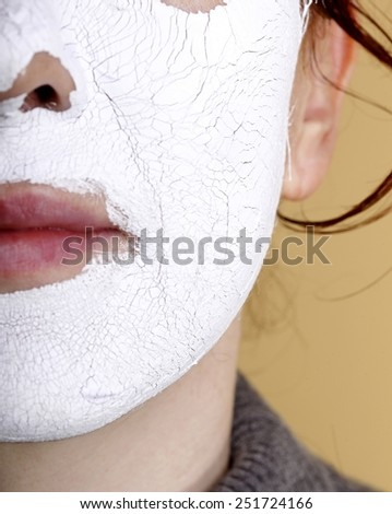 Mature woman with facial Mask. Spa