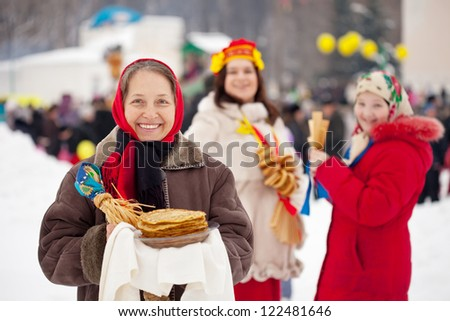 Mature woman with pancake during  Shrovetide at Russia