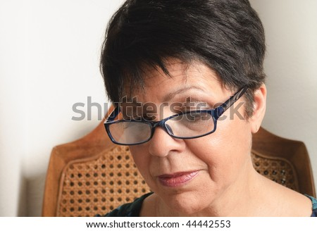 mature woman with short hair and glasses - stock photo