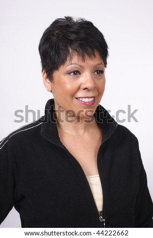 mature woman with short hair in black jacket - stock photo