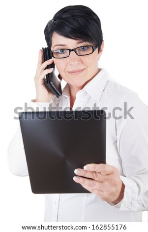 Mature woman with smartphone and digital tablet