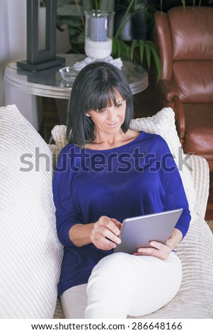 Mature woman with tablet - stock photo