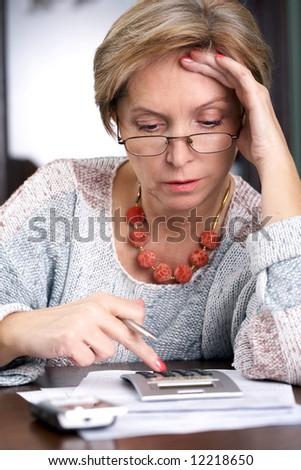 Mature woman working - stock photo