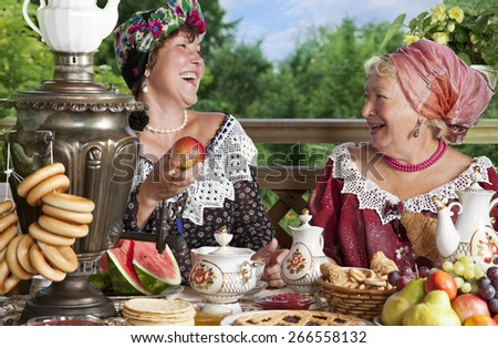 Mature women from the Victorian era carefree laugh while having a cup of tea. Kustodiev Russian artist style  - stock photo