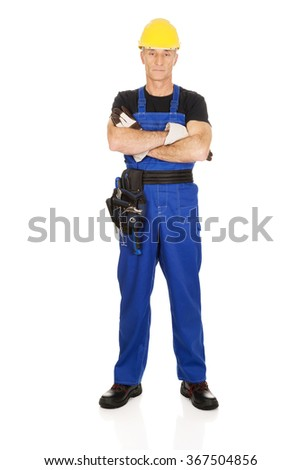 Mature worker with folded arms - stock photo