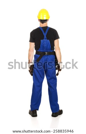 Mature worker with hard hat back to camera. - stock photo
