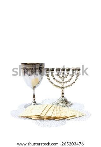 Matzo, menorah and wine for passover celebration on white background - stock photo