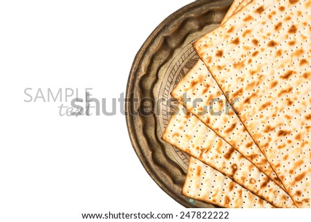 Matzo on vintage plate for passover holiday isolated on white background - stock photo