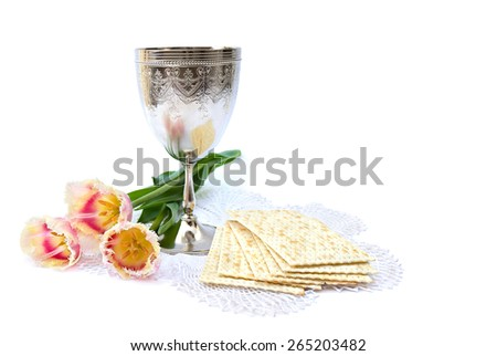 Matzo, wine and tulips for passover celebration on white background - stock photo