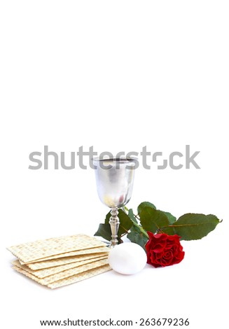 Matzo, wine, egg and red rose for passover celebration - stock photo