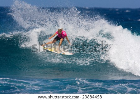 MAUI, HAWAII - DECEMBER 18, 2008:   Professional surfer Stephanie Gilmore does a huge power turn during the Billabong Pro Maui - December 18, 2008 in Maui, HI. - stock photo