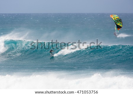 "MAUI, HI - MARCH 17: A guy rides a giant wave at the legendary big wave surf break ""Jaws"" March 17, 2015 in Maui, Hi."