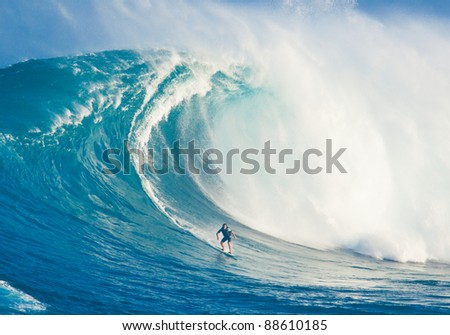 "MAUI, HI - MARCH 13: Professional surfer Marcio Freire rides a giant wave at the legendary big wave surf break known as ""Jaws"" during one the largest swells of the winter March 13, 2011 in Maui, HI."