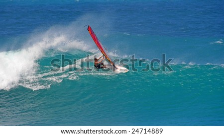 MAUI - JANUARY 17: Windsurfer fights for it in big wave contest at Ho'okipa on Maui's northshore on January 17, 2009.