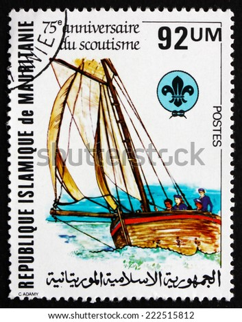 MAURITANIA - CIRCA 1982: a stamp printed in the Mauritania shows Boating Scene, Scouting Year, circa 1982 - stock photo