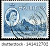 MAURITIUS - CIRCA 1960: A stamp printed in Mauritius Rempart Mountain, circa 1960 - stock photo