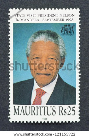 MAURITIUS - CIRCA 1998: postage stamp printed in Republic of Mauritius showing an image of Nelson Mandela, circa 1998. - stock photo