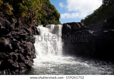 MAURITIUS - JUNE 25: The Grand River waterfall - view from boat on June 25 2013, at Mauritius. This waterfall is one of the east coast's most popular attractions. - stock photo
