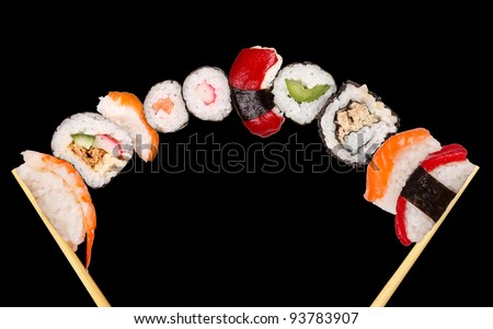 Maxi sushi, isolated on black background - stock photo