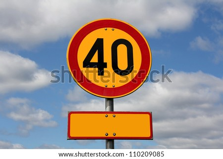 Maximum speed 40 km per hour and blank letter plate for your text, with blue sky and clouds as background.