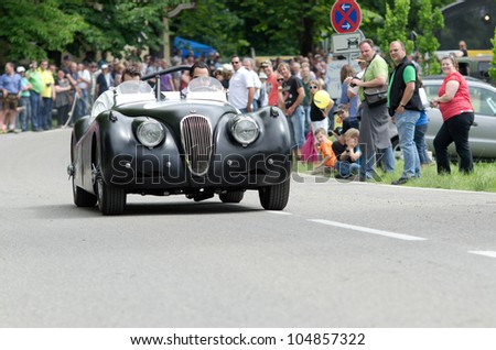 MAXLRAIN - JUNE 7: Jaguar XK120S, year of construction 1954, at the ADAC (german automobile club) historic rally in Maxlrain, Germany on June 7, 2012. - stock photo