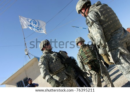 MAXMUR CITY, IRAQ-JANUARY 26:Unidentified USA soldiers stands guard in a check point on January 26, 2007 in Maxmur, Iraq. - stock photo