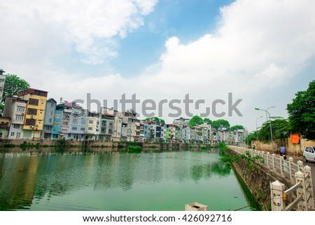 May 16, 2016: A lakeside residential corner in Hanoi, Vietnam. The houses tubes built adjacent  in a residential area along the lake in Hanoi, Vietnam.