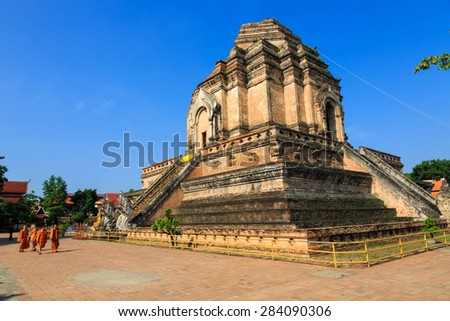 May 29, 08.15 am, Chiang Mai, Thailand : The picture of a groups of Buddhist monk student walk pass the broken pagoda on their way to school in this temple. Represent to education in the temple.    - stock photo