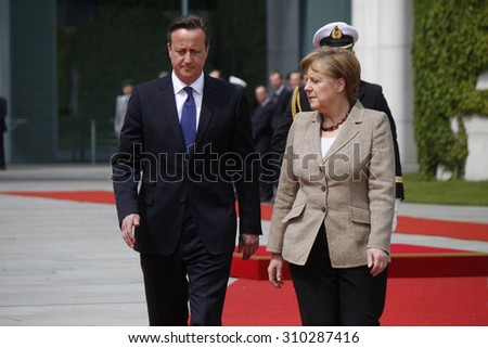 MAY 29, 2015 - BERLIN: David Cameron, Angela Merkel at a reception with military honours at the Chanclery in Berlin. - stock photo