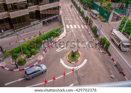 May 29, 2016 Cars in a roundabout in a high view, traffic circle, turning circle, roundabout top view at siam discovery, Bangkok City, Thailand,
