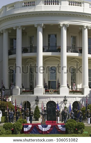 MAY 7 2007: Display of American Flags by military branches in front of the Presidential Seal as part of the Official Welcoming of Her Majesty Queen Elizabeth II and Prince Philip Duke of Edinburgh, May 7, 2007 - stock photo
