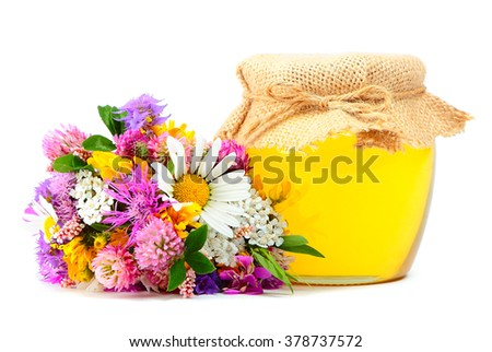 May honey in jar with miscellaneous flowers isolated on white background - stock photo