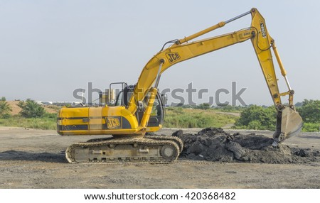 May 14, 2016 - Kuala Lumpur, Malaysia : A close-up of �yellow excavator on a construction site against blue sky. - stock photo
