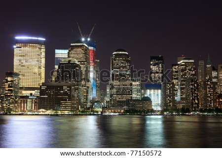may 5, 2011. Manhattan, lower New York financial offices(downtown)  from Jersey city. One World Trade Center building under construction and color lighted. USA celebrates Osama Bin Laden Death - stock photo