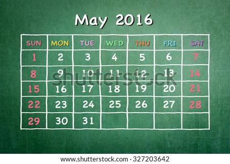 May 2016: Monthly calendar on green chalkboard background with colorful pastel day and dates in freehand grid time table chalk drawing: School/ business time planner conceptual idea for new year