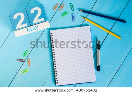 May 22nd. Image of may 22 wooden color calendar on blue background.  Spring day, empty space for text - stock photo