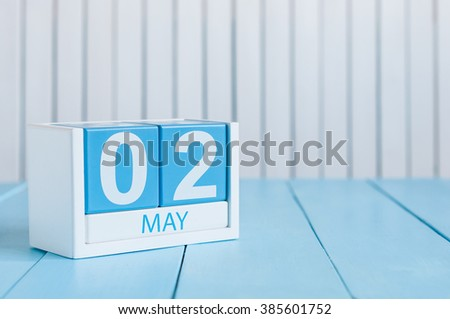 May 2nd. Image of may 2 wooden color calendar on white background.  Spring day, empty space for text.  last spring month. - stock photo
