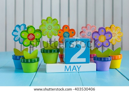May 2nd. Image of may 2 wooden color calendar on white background with flowers. Spring day, empty space for text.  last spring month - stock photo