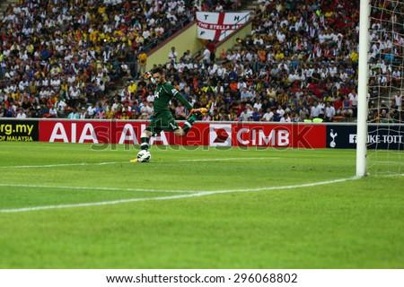 May 27, 2015 - Shah Alam, Malaysia: Tottenham Hotspur's captain and goalkeeper Hugo Lloris takes a goal kick in a friendly match in Malaysia. Tottenham Hotpsur is on a Asia-Australia tour. - stock photo