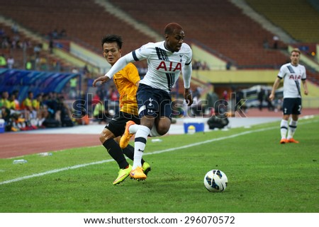 May 27, 2015- Shah Alam, Malaysia: Tottenham Hotspur's Danny Rose (white) fights for the ball with Malaysia's Joseph Kalang (orange) in a friendly match. Tottenham Hotspur is on a Asia-Australia tour. - stock photo